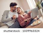 couple having breakfast at home ...   Shutterstock . vector #1039963324