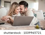 young couple relaxing on sofa... | Shutterstock . vector #1039965721