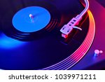 turntable vinyl record player.... | Shutterstock . vector #1039971211