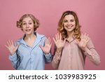 two young women  students smile ...   Shutterstock . vector #1039983925