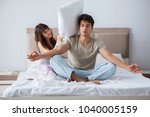young family meditating in the... | Shutterstock . vector #1040005159
