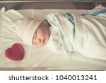 newborn baby boy sleeping in... | Shutterstock . vector #1040013241