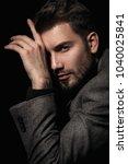 handsome brutal man in gray... | Shutterstock . vector #1040025841