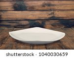 plate on wood background | Shutterstock . vector #1040030659