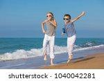 two happy little children... | Shutterstock . vector #1040042281