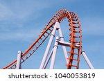 roller coaster on blue sky... | Shutterstock . vector #1040053819