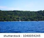scene of tranquility island ... | Shutterstock . vector #1040054245
