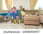happy parents with kids. family ... | Shutterstock . vector #1040054557