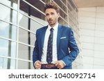 handsome male model posing... | Shutterstock . vector #1040092714