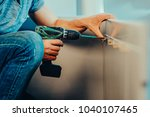 joiner collects a new cupboard... | Shutterstock . vector #1040107465