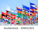Small photo of International Flags blowing in the wind