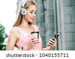 happy girl enjoys her life ... | Shutterstock . vector #1040155711