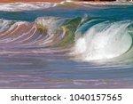 wave breaking onto shore off...   Shutterstock . vector #1040157565
