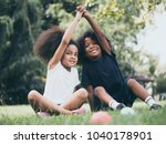 little boy and girl playing... | Shutterstock . vector #1040178901