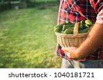 farmer holding basket with... | Shutterstock . vector #1040181721