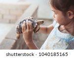 cute asian child girl holding...   Shutterstock . vector #1040185165