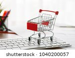 shopping cart on a laptop... | Shutterstock . vector #1040200057