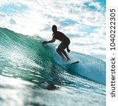 surfer silhouette in backlit... | Shutterstock . vector #1040222305
