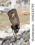 Small photo of An ancient greek artefact, metal theater mask, Filippoi, Greece