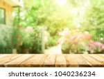 empty wood table top on blur... | Shutterstock . vector #1040236234