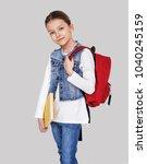 beautiful little schoolgirl... | Shutterstock . vector #1040245159