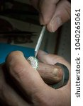 inlaying gemstone on the ring | Shutterstock . vector #1040265061