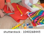 couturier sews a dress in the... | Shutterstock . vector #1040268445