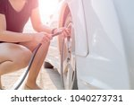 driver filling air into a car... | Shutterstock . vector #1040273731