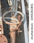 Small photo of Old and rusty steal pipe fitting and valve,Big valve at scarp yard.