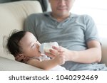 happy asian family at home.... | Shutterstock . vector #1040292469