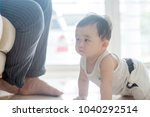 nine months old baby boy... | Shutterstock . vector #1040292514