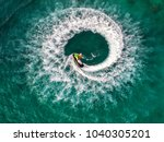 people are playing jet ski at... | Shutterstock . vector #1040305201
