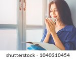 asian girl sitting by the... | Shutterstock . vector #1040310454