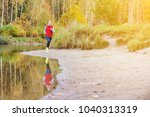 a girl runs in the forest on... | Shutterstock . vector #1040313319