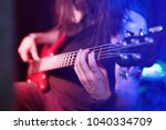 the bass guitar player is on... | Shutterstock . vector #1040334709