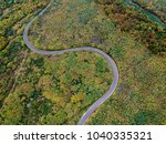 aerial view of a curly road | Shutterstock . vector #1040335321