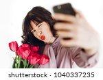 happy stylish girl taking... | Shutterstock . vector #1040337235