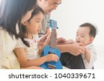 parents and children playing... | Shutterstock . vector #1040339671
