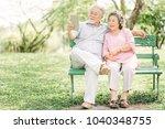 happy senior asian couple... | Shutterstock . vector #1040348755