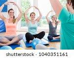 Small photo of Moms in postnatal regression course doing yoga asana