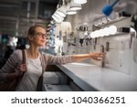 pretty  young woman choosing... | Shutterstock . vector #1040366251