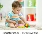 baby boy toddler playing wooden ... | Shutterstock . vector #1040369551