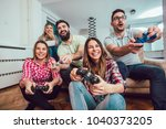 group of friends play video... | Shutterstock . vector #1040373205