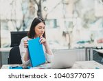 intern at the office working on ... | Shutterstock . vector #1040377075