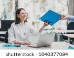 intern at the office working on ... | Shutterstock . vector #1040377084