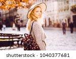 girl in a hat walks the city in ...   Shutterstock . vector #1040377681