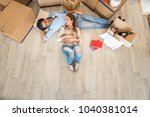 couple moving to a new home  ... | Shutterstock . vector #1040381014