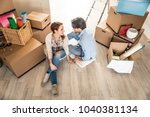 couple moving to a new home  ... | Shutterstock . vector #1040381134