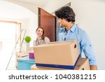 couple moving to a new home  ... | Shutterstock . vector #1040381215