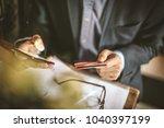 business man holding credit... | Shutterstock . vector #1040397199